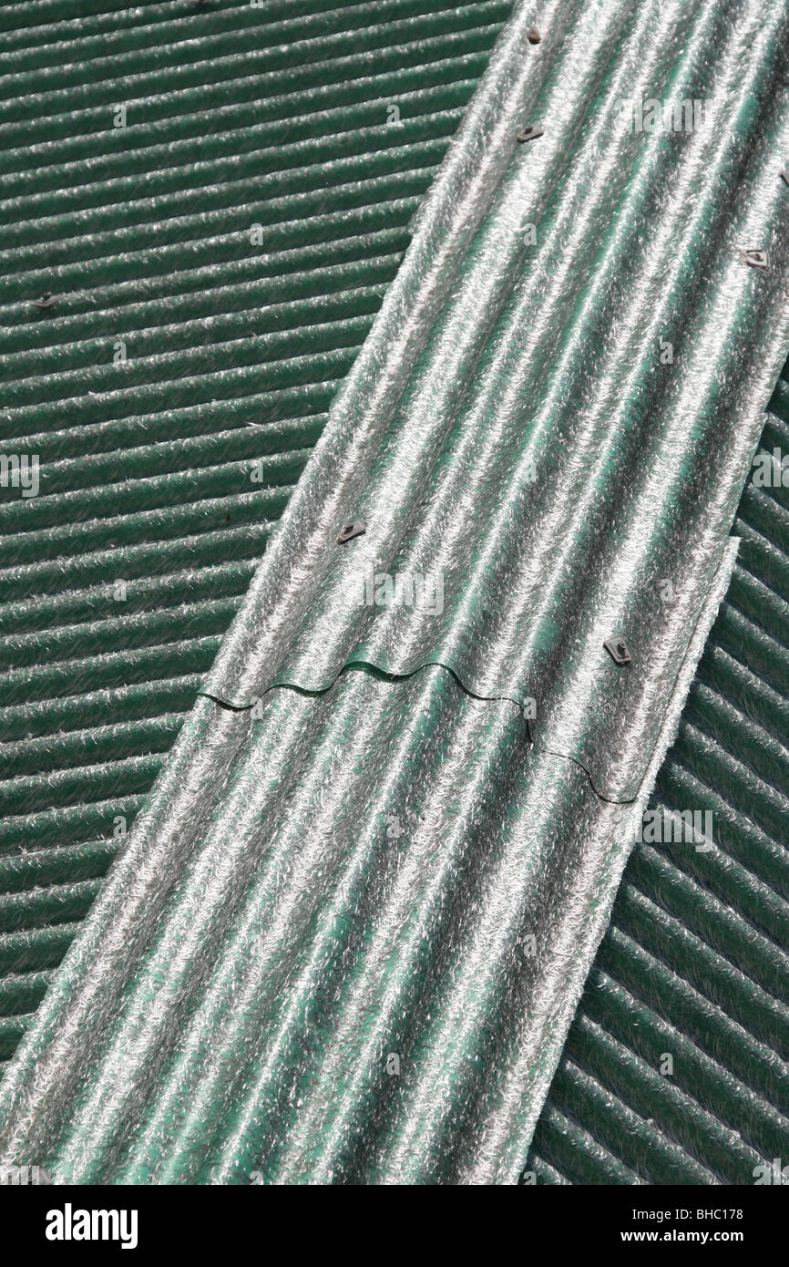 asbestos type sheets on property roof in sun Stock Photo