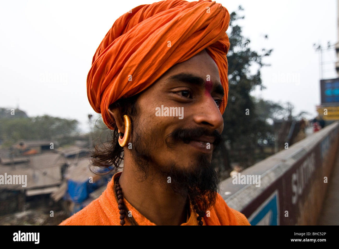 An Indian sadhu with a  big earring. - Stock Image