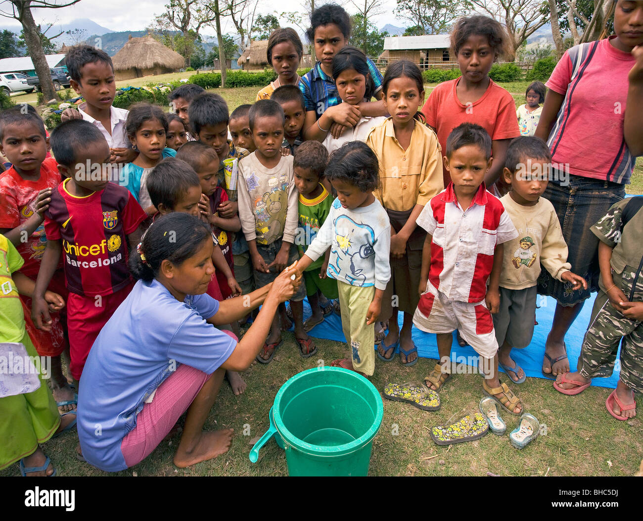 Brigitte Madeira of Oxfam-Covalima teaches children hygiene at remote impoverished mountain village Welua in East - Stock Image