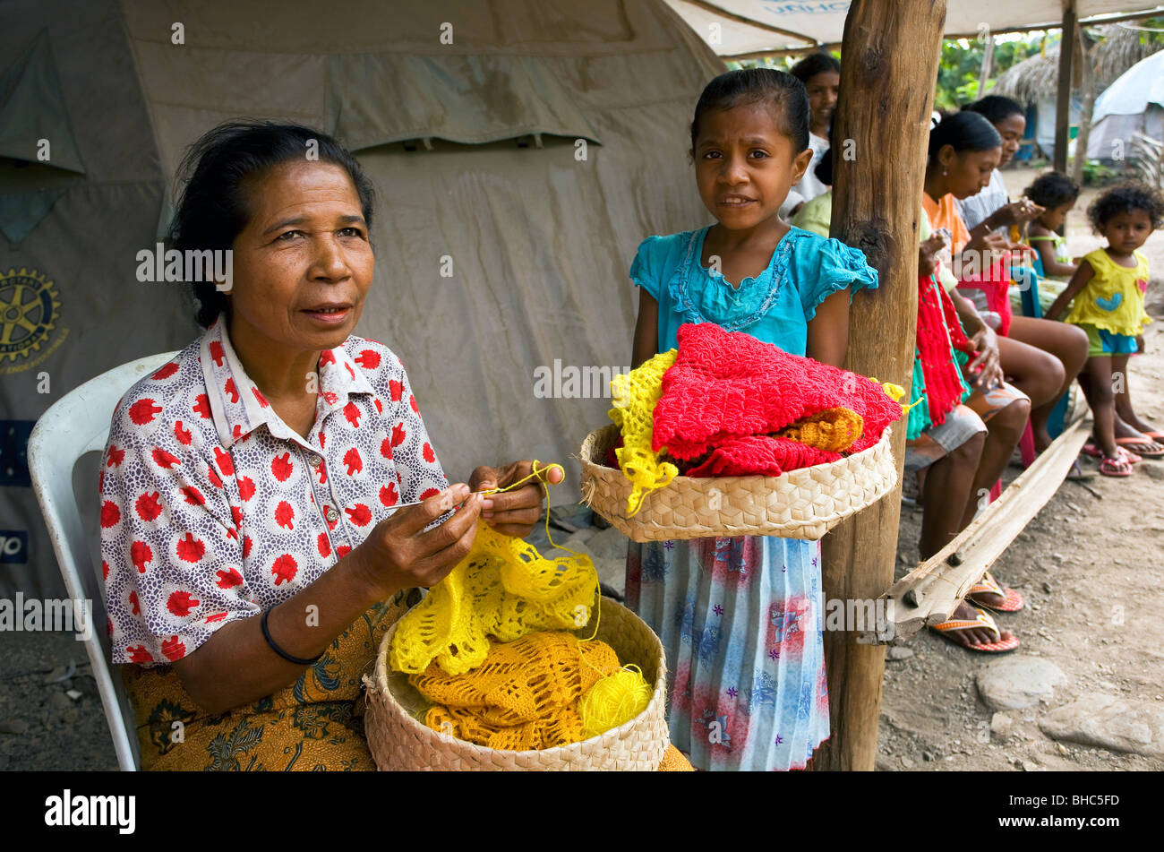 Impoverished village women at an organised community crotchet class to earn some money East Timor - Stock Image