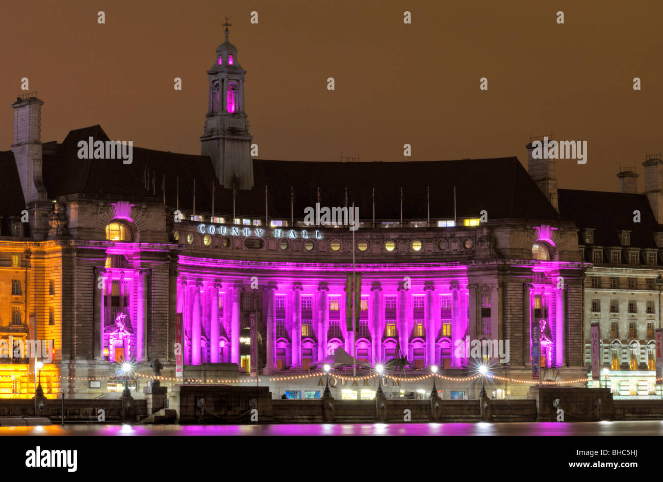 Nigh time at an illuminated County Hall, South Bank, London SE1, United Kingdom - Stock Image