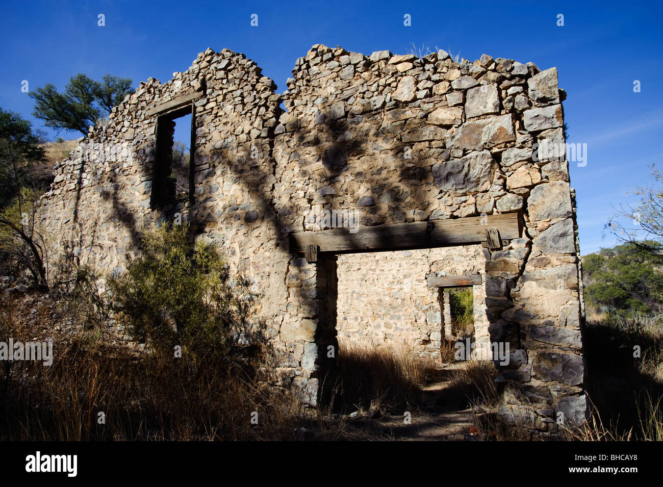 Ruins of an old mining camp in the mountains of Southern Arizona.  These substantial structures are evidence of - Stock Image