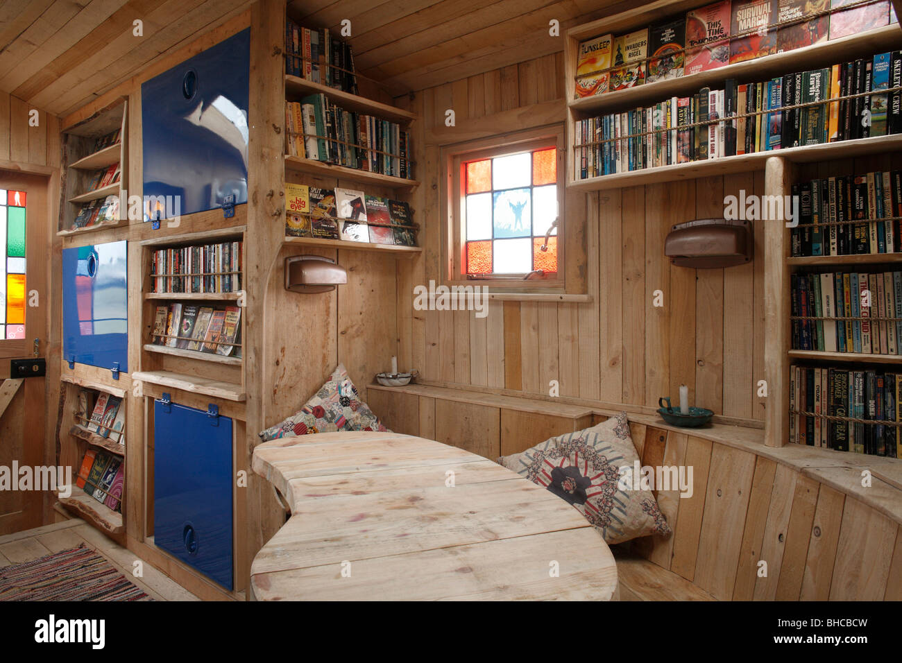 Heather and Ivan Morison's sci-fi library in a wooden trailer - Stock Image