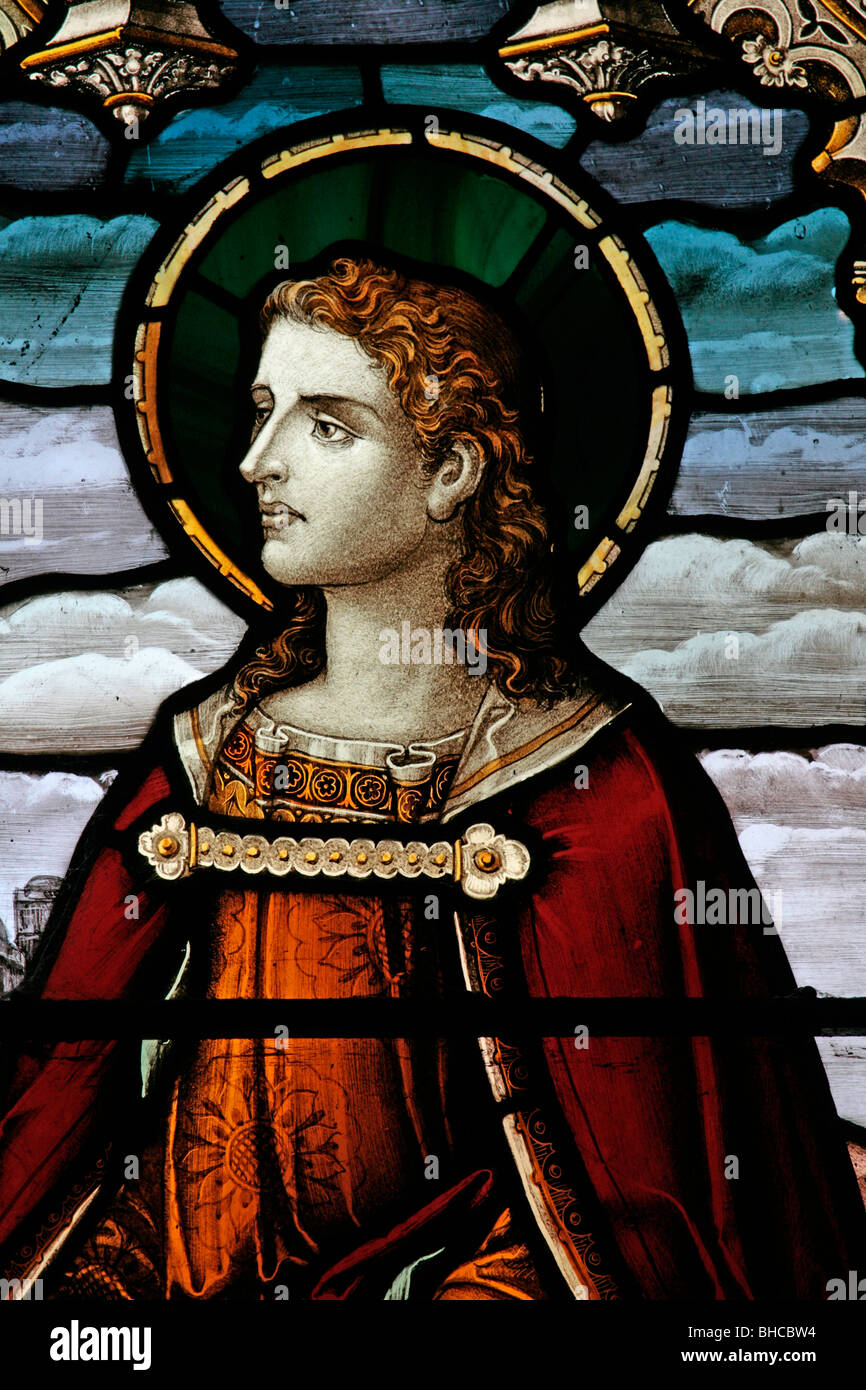 Detail from a stained glass window depicting Saint John, Over Silton Church, North Yorkshire - Stock Image