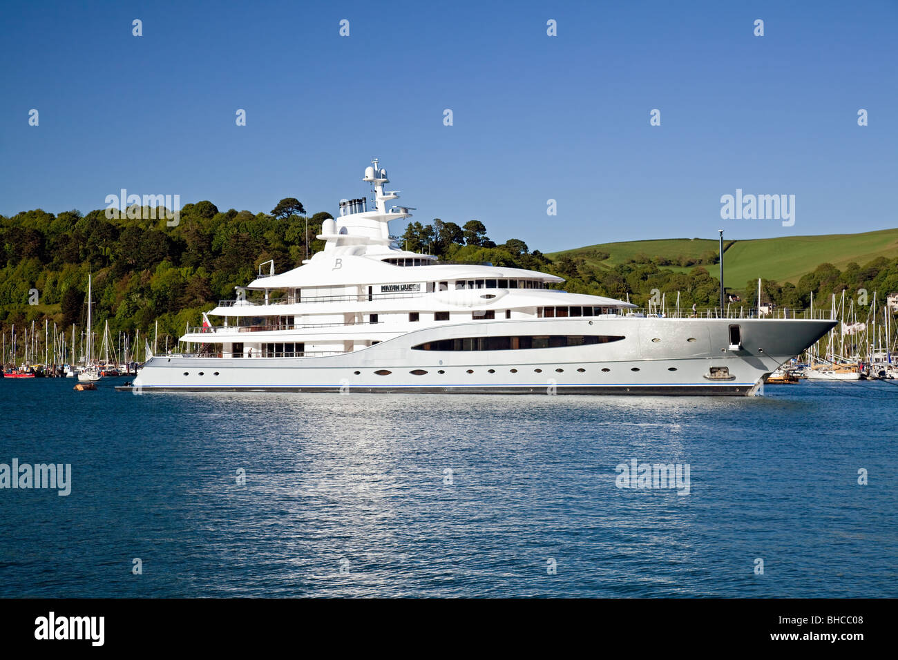 England Devon Kingswear with moored luxury yacht 'Mayan Queen' - Stock Image