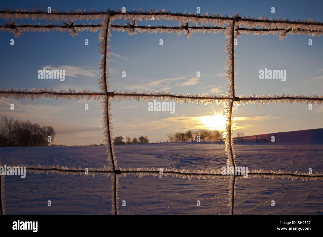 New Palestine, Indiana - Frost on a farm fence at sunrise. - Stock Image
