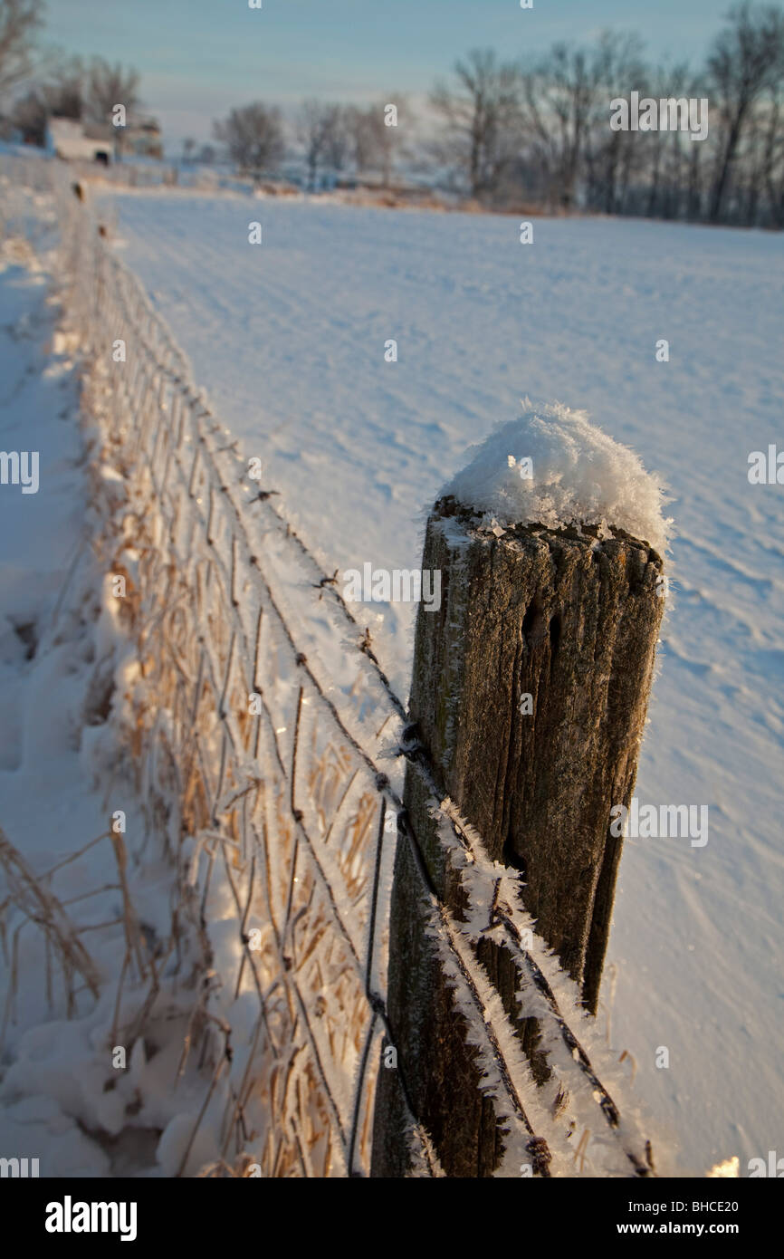 New Palestine, Indiana - Frost and snow on a fence on an Indiana farm. - Stock Image