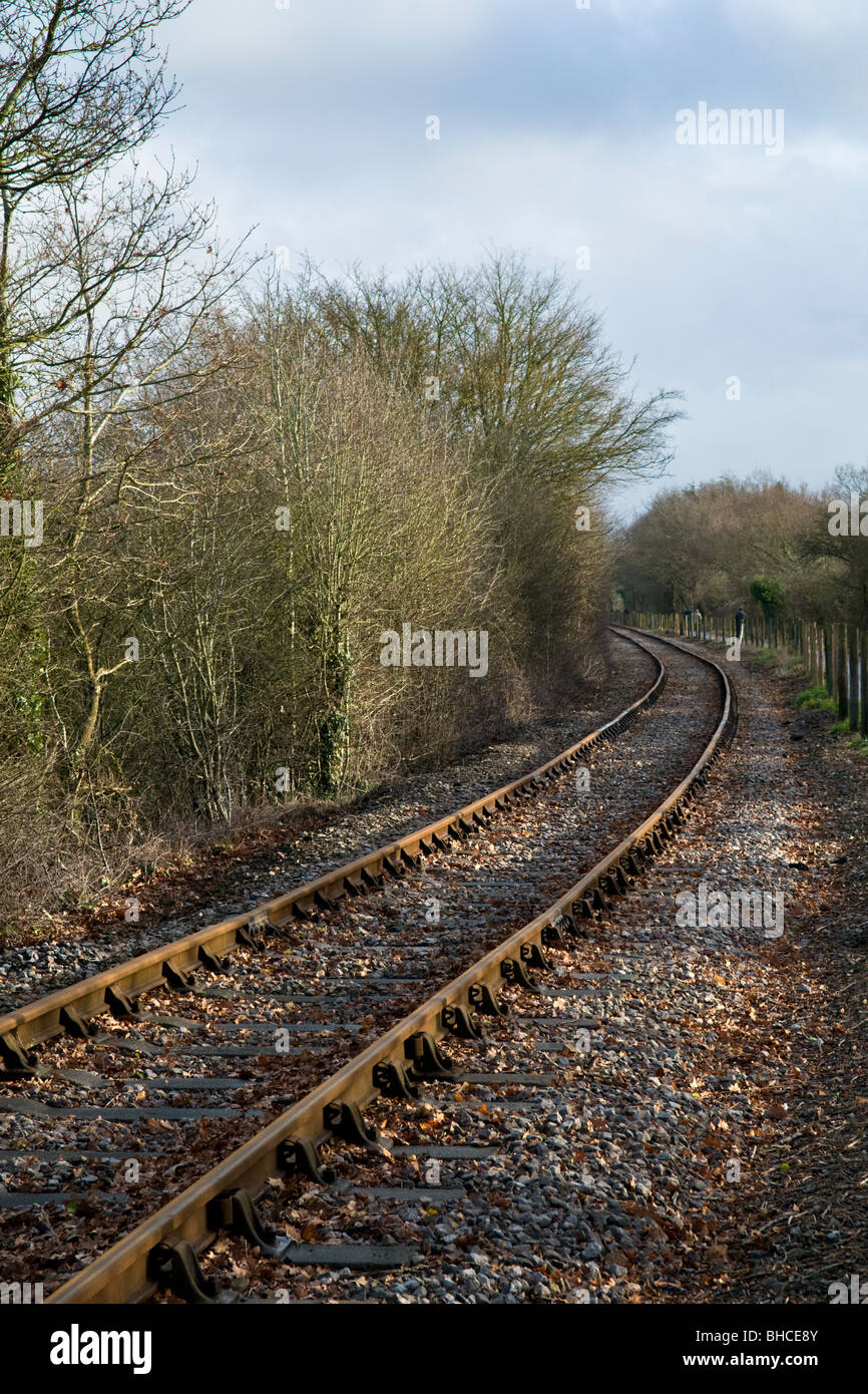 Railway tracks in winter on the Avon Valley railway line with at Bitton in Bristol - Stock Image