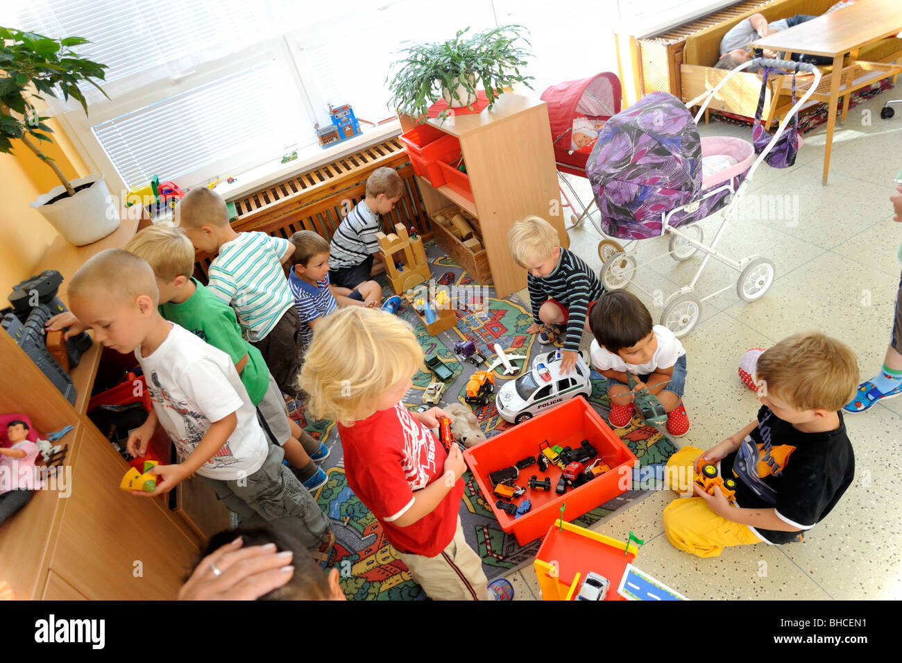 Kinder Garden: Preschool Children Playing In Class With Toys Stock Photo