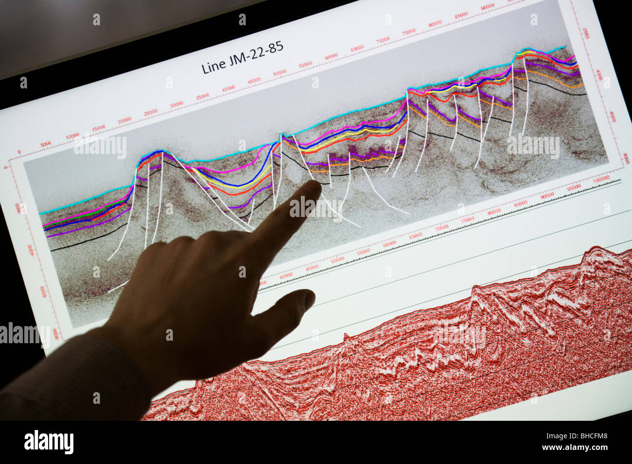 Thorarinn S. Arnarson, Oceanographer and Hydrocarbon Licensing Manager, shows a map with seismic reflection lines... - Stock Image