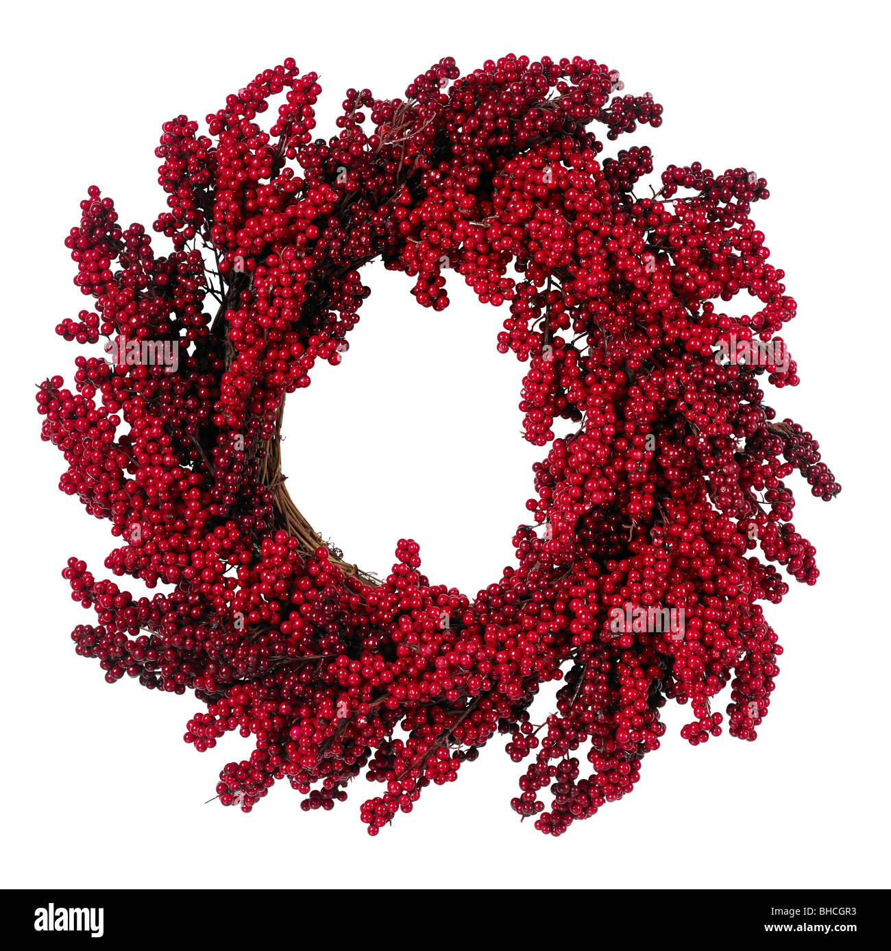 Red Christmas ornament holly berries wreath - Stock Image