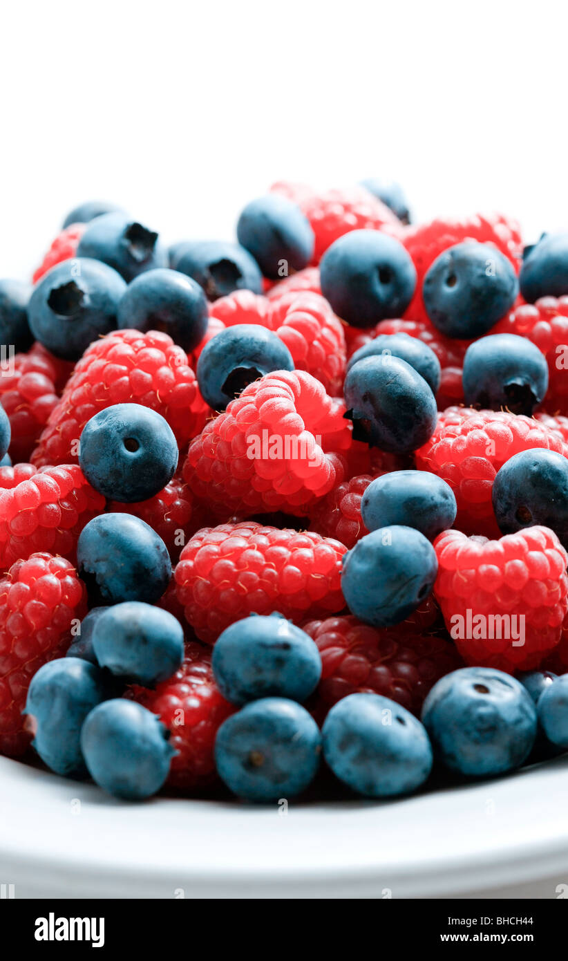 Close up of mixed berries in a bowl - shot in studio - Stock Image