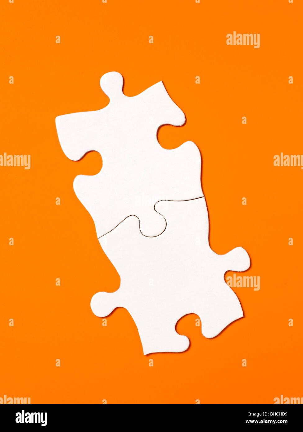 Orange white Puzzle pieces elevated view - Stock Image