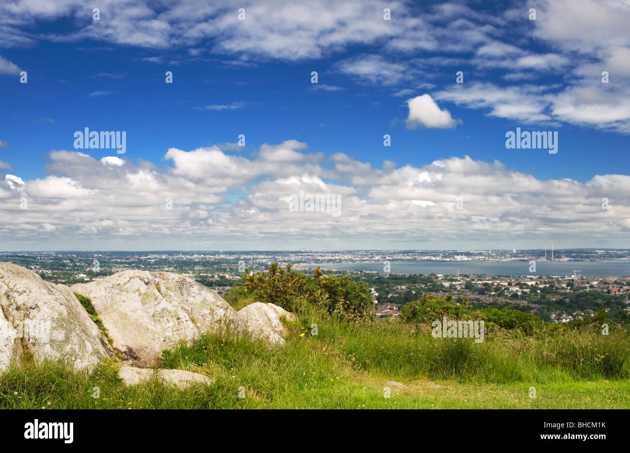 View northwards over Dun Laoighaire and Dublin Bay, from Killiney Hill, with outcrop of Leinster Granite in the - Stock Image