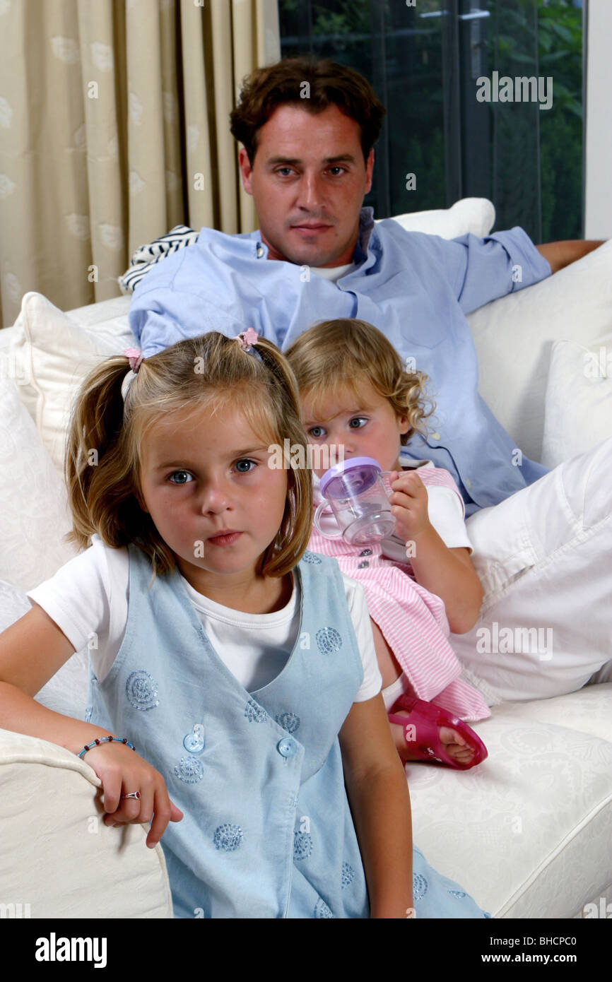 Single parent father with two children at home - Stock Image