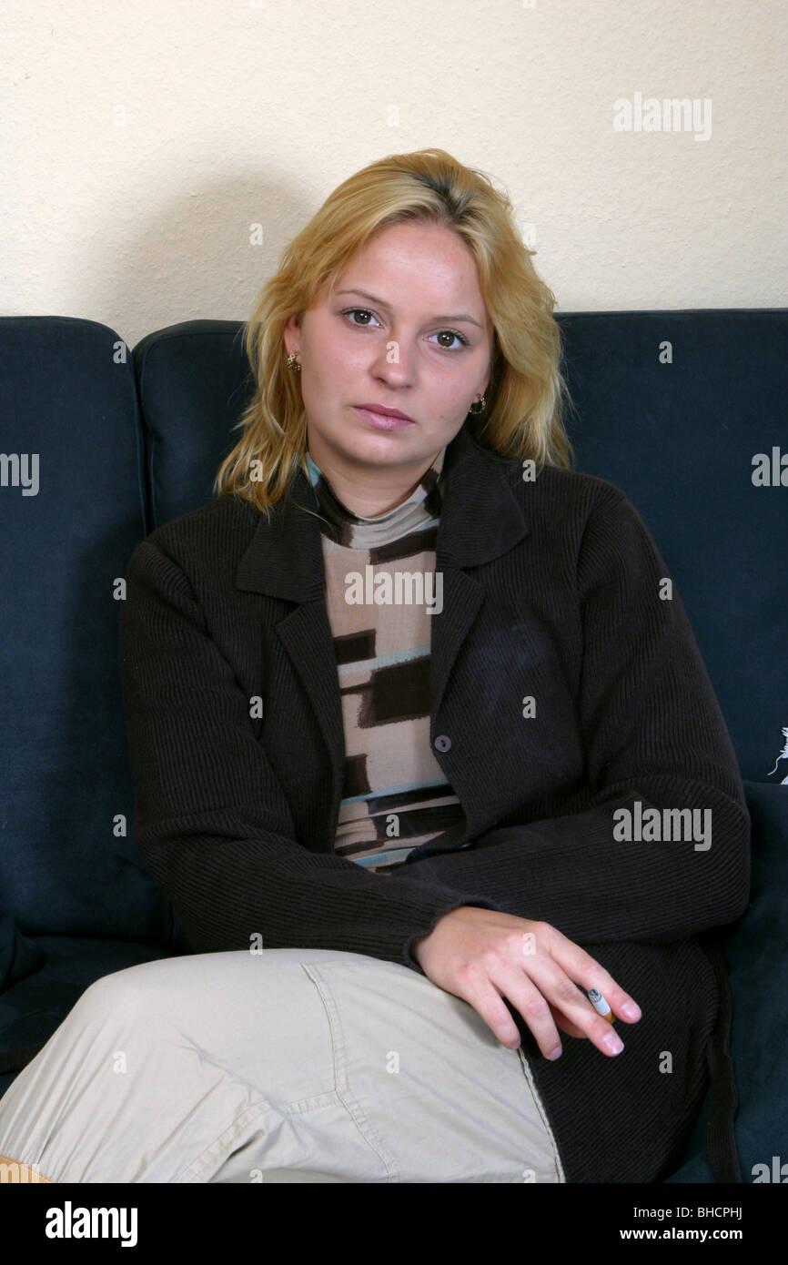 Woman smoking a cigarette - Stock Image