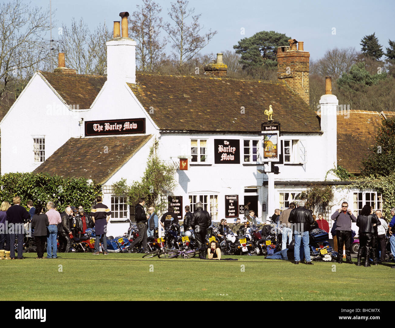 Harley Davidson motorbikes at bikers annual rally parked outside country pub on village green in Tilford, Surrey, - Stock Image