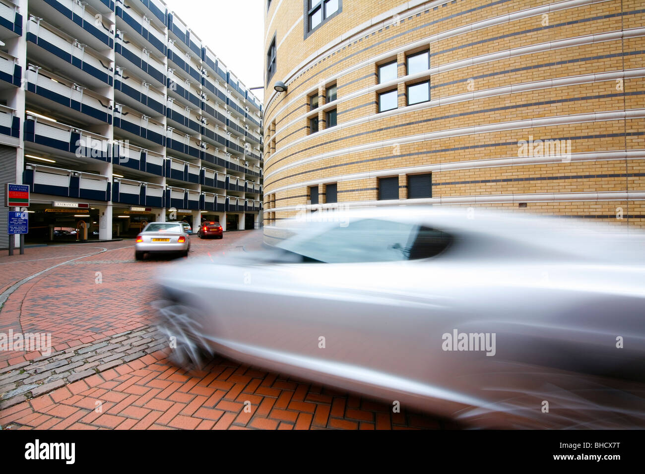 Cars in a queue waiting to park on the multi storey car park in Brindleyplace, Birmingham, West Midlands. - Stock Image