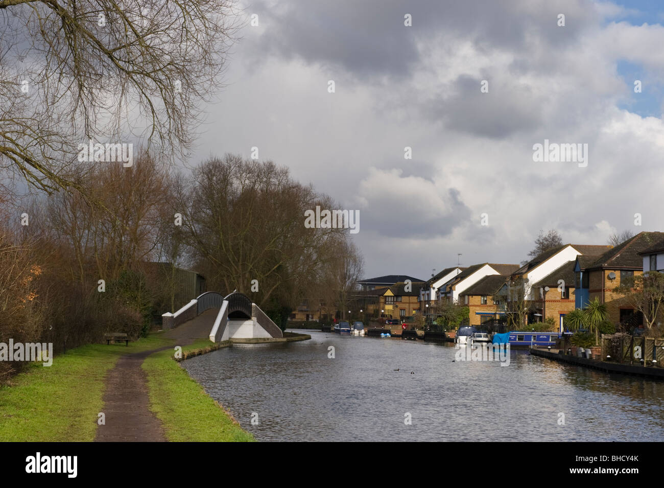 Grand Union canal landscape towpath and houses near Harefield Middlesex West London UK - Stock Image