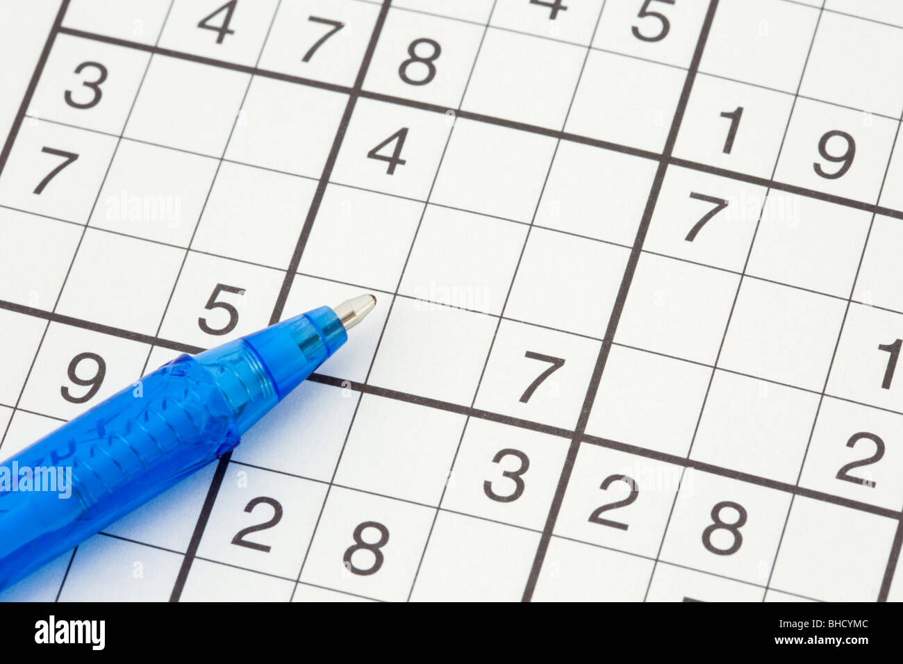 Suduko numbers game and pen close-up - Stock Image
