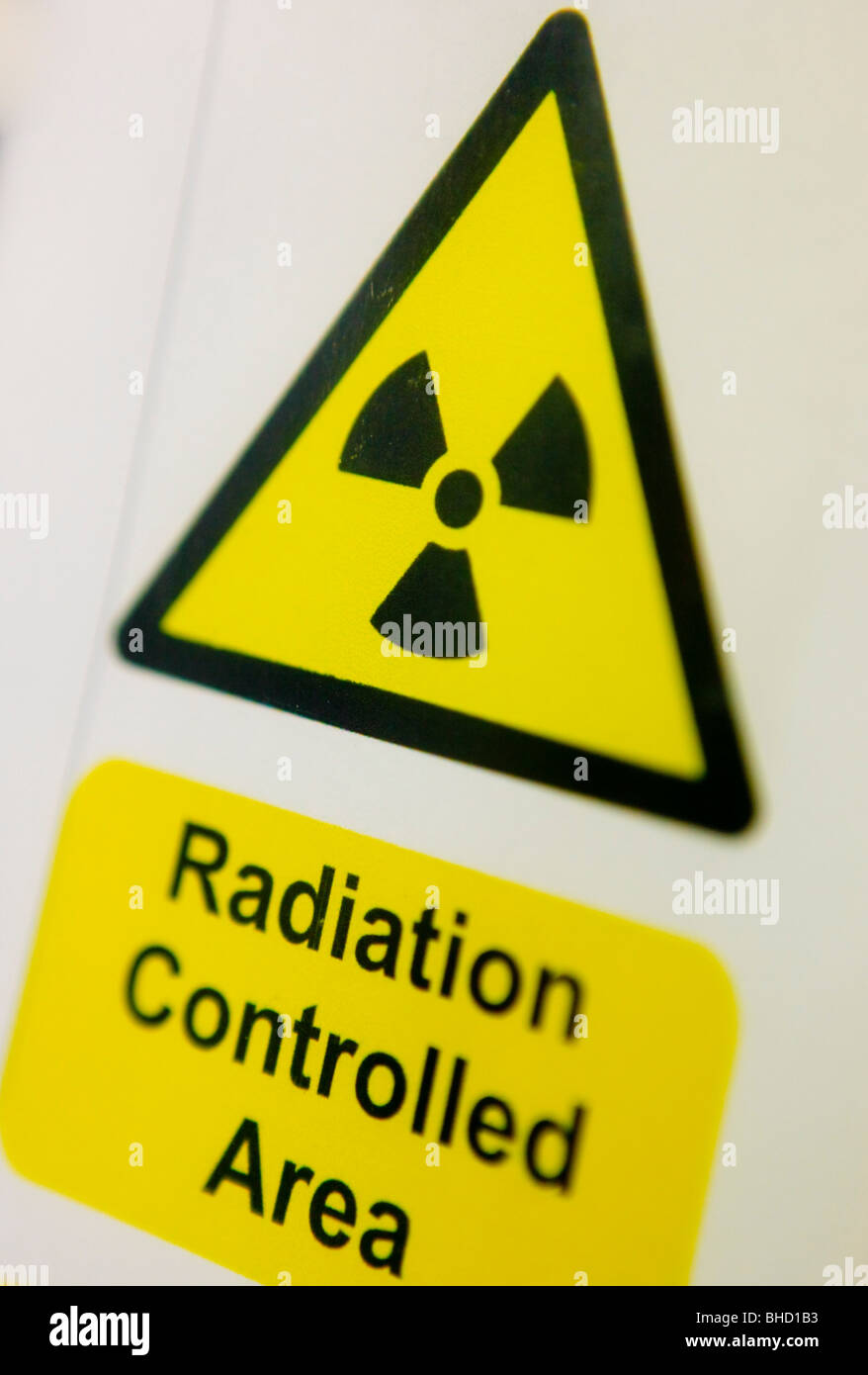 Radiation controlled area sign in an NHS hospital in Stafford. - Stock Image