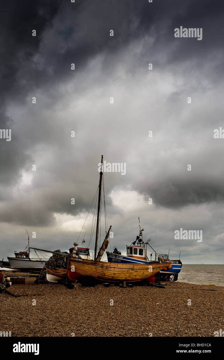 A wooden fishing boat beached at Deal in Kent. - Stock Image