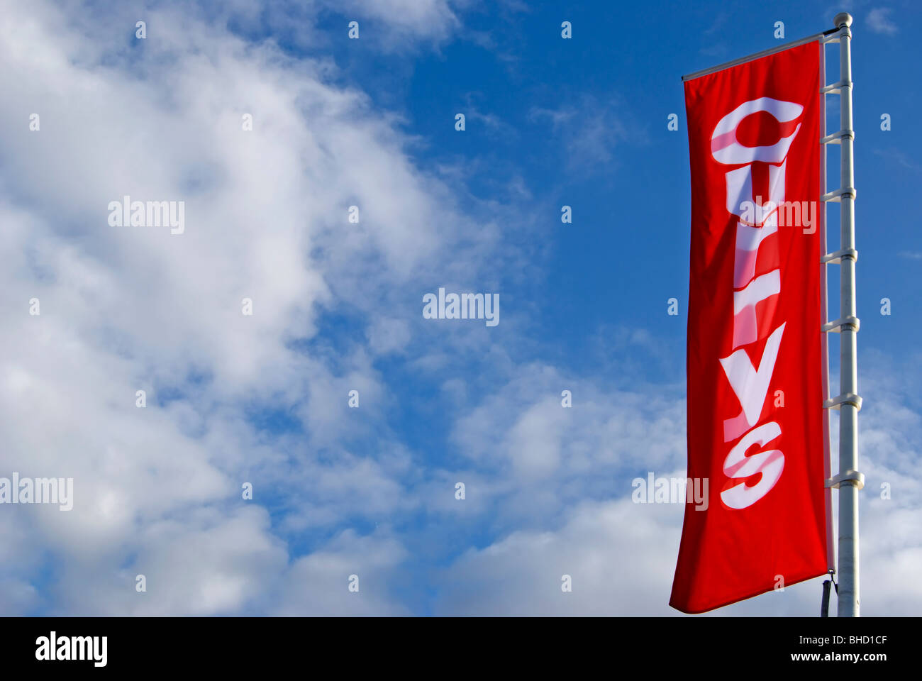 red and white banner for the electrical goods retail chain currys, on the great west road, brentford, west london, - Stock Image