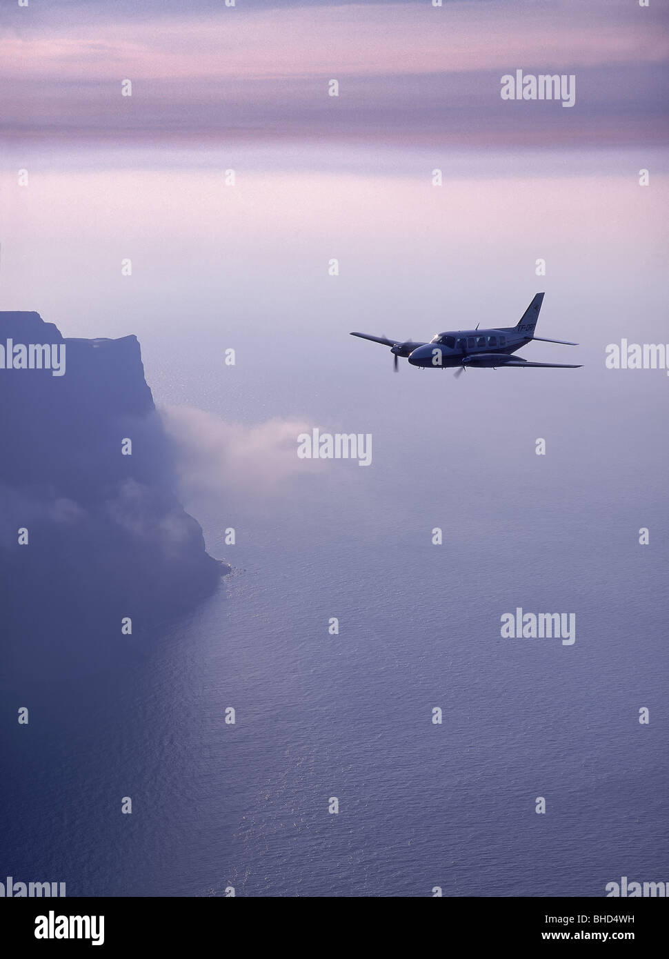 Cessna flying by Hornbjarg cliffs, Iceland - Stock Image