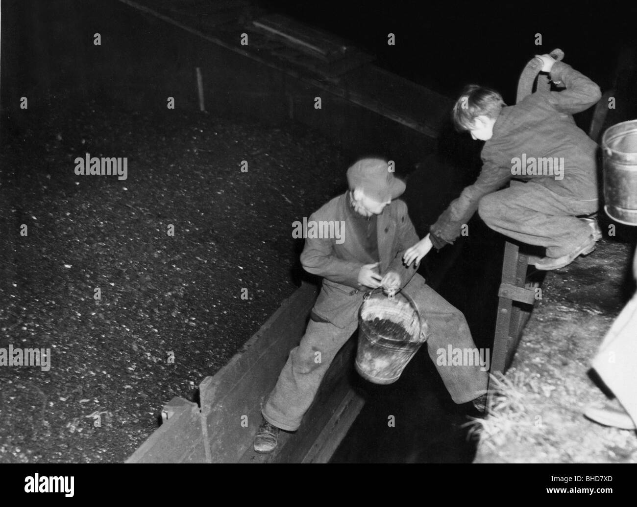 postwar period, hardship, misery and starvation, two young men stealing coal, 1940s, Additional-Rights-Clearances - Stock Image