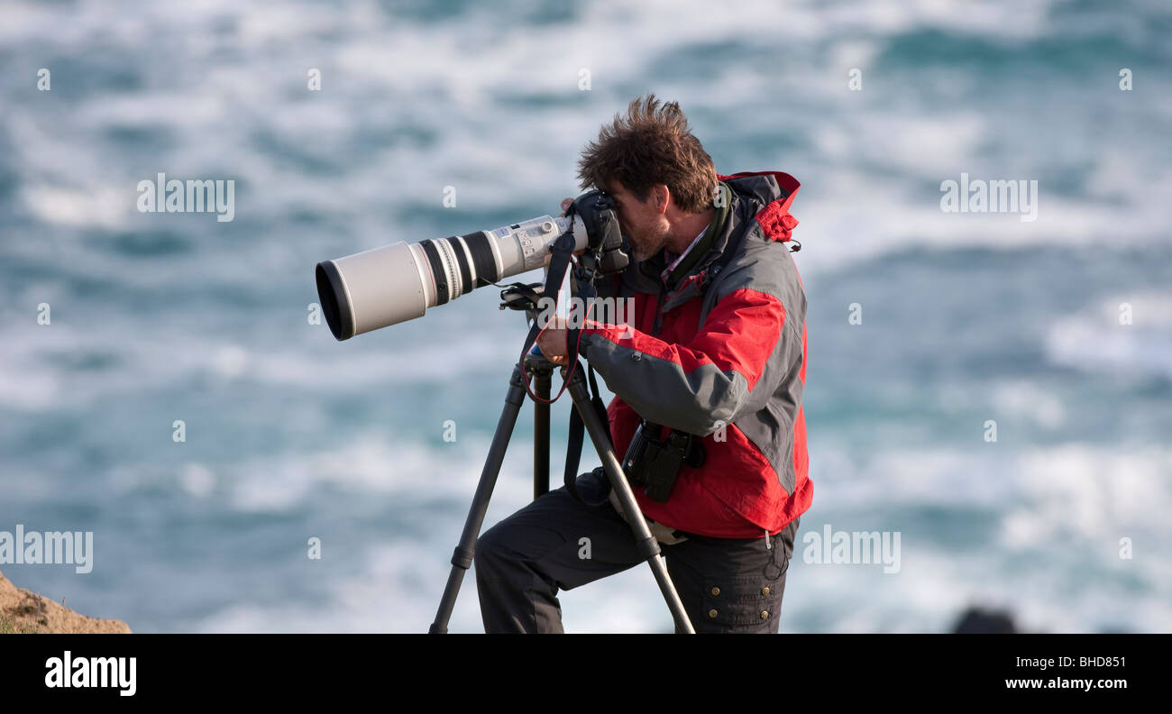 Photographer with telephoto lens, Snaefellsnes Peninsula, Iceland - Stock Image