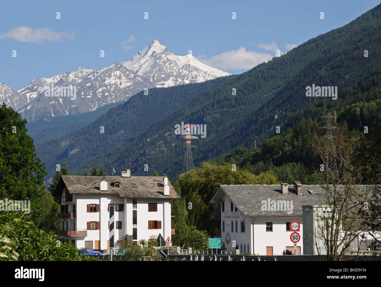 Fromagerie Valdigne Mont Blanc in the Aosta Valley Italy with the snow capped peak of La Grivola in the Gran Paradiso - Stock Image
