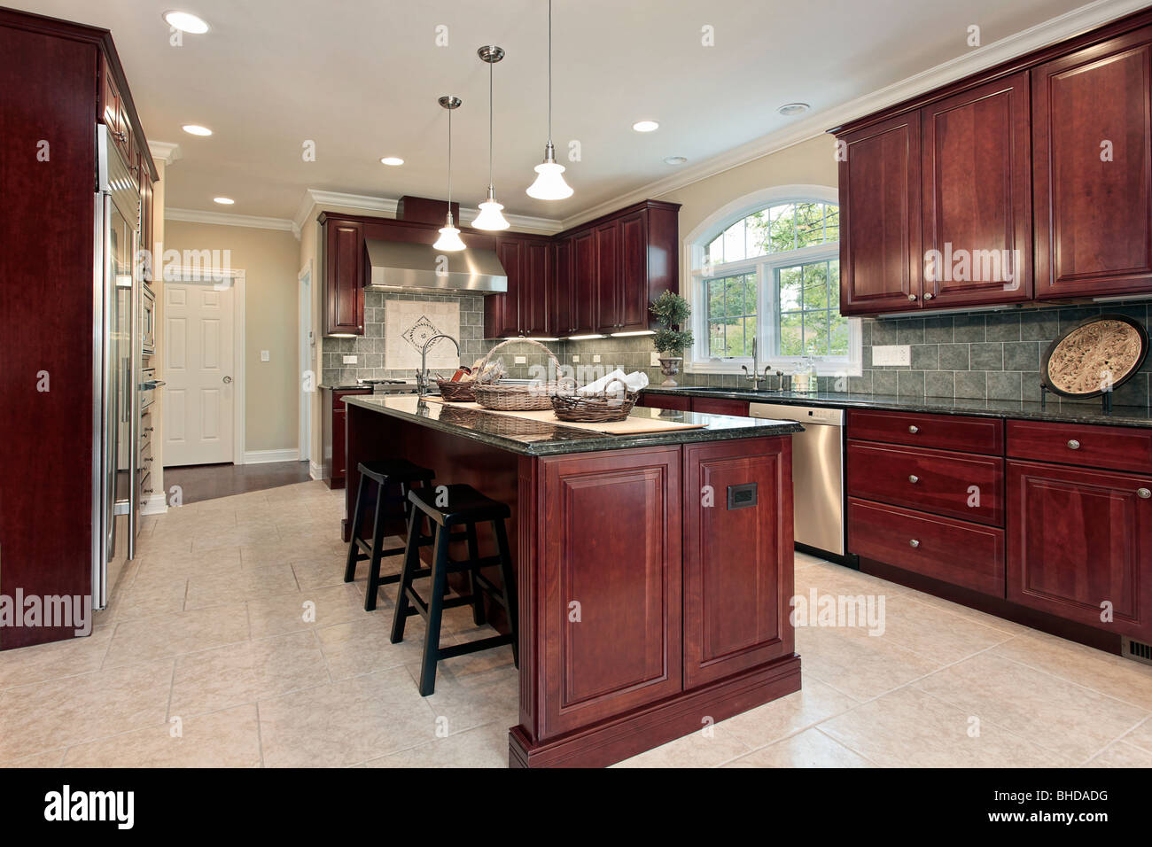 Kitchen in luxury home with cherry wood cabinetry Stock ...
