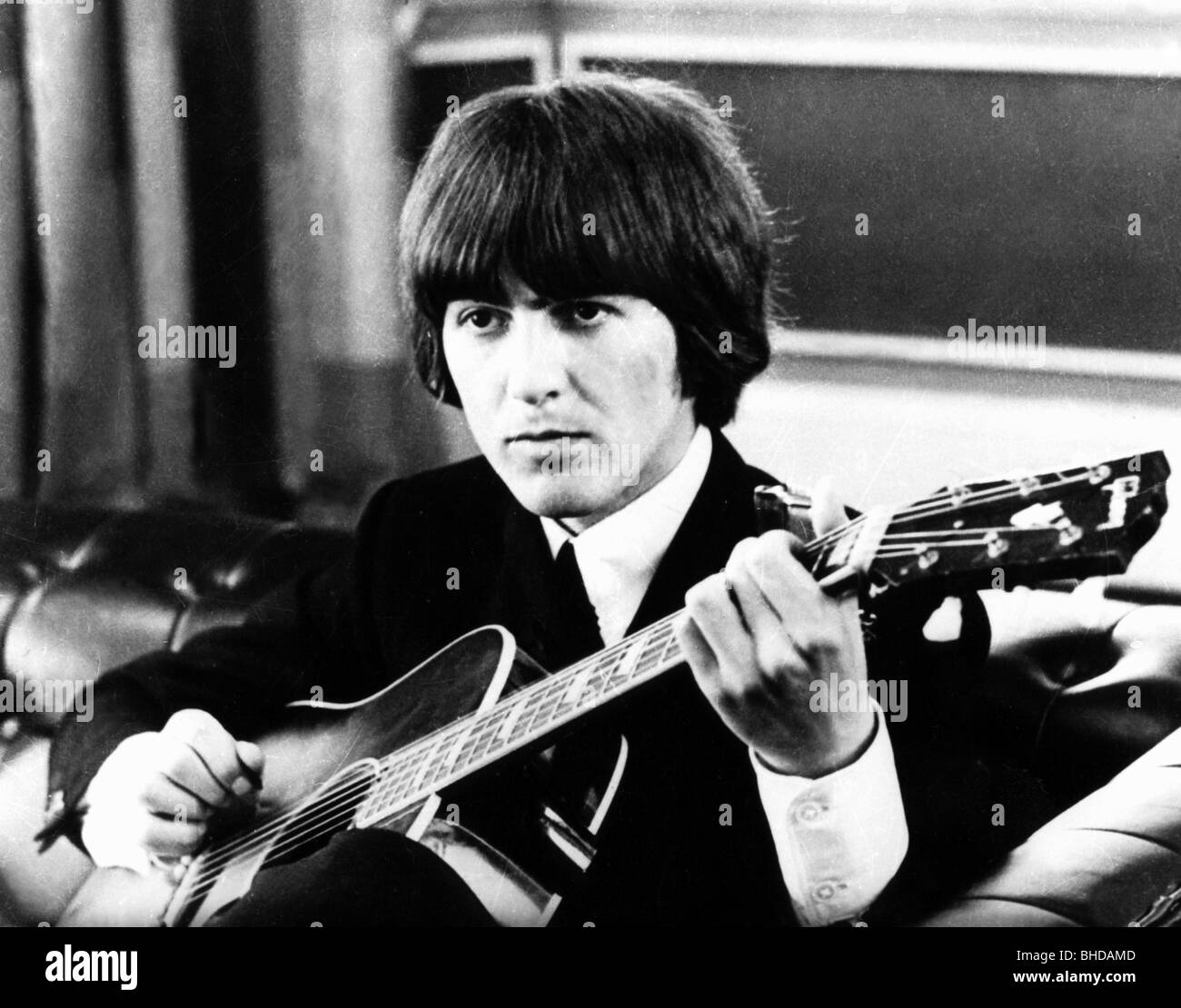 Harrison, George, 25.2.1943 - 29.11.2001, British musician, half length with guitar, Munich, 1966, , Additional - Stock Image