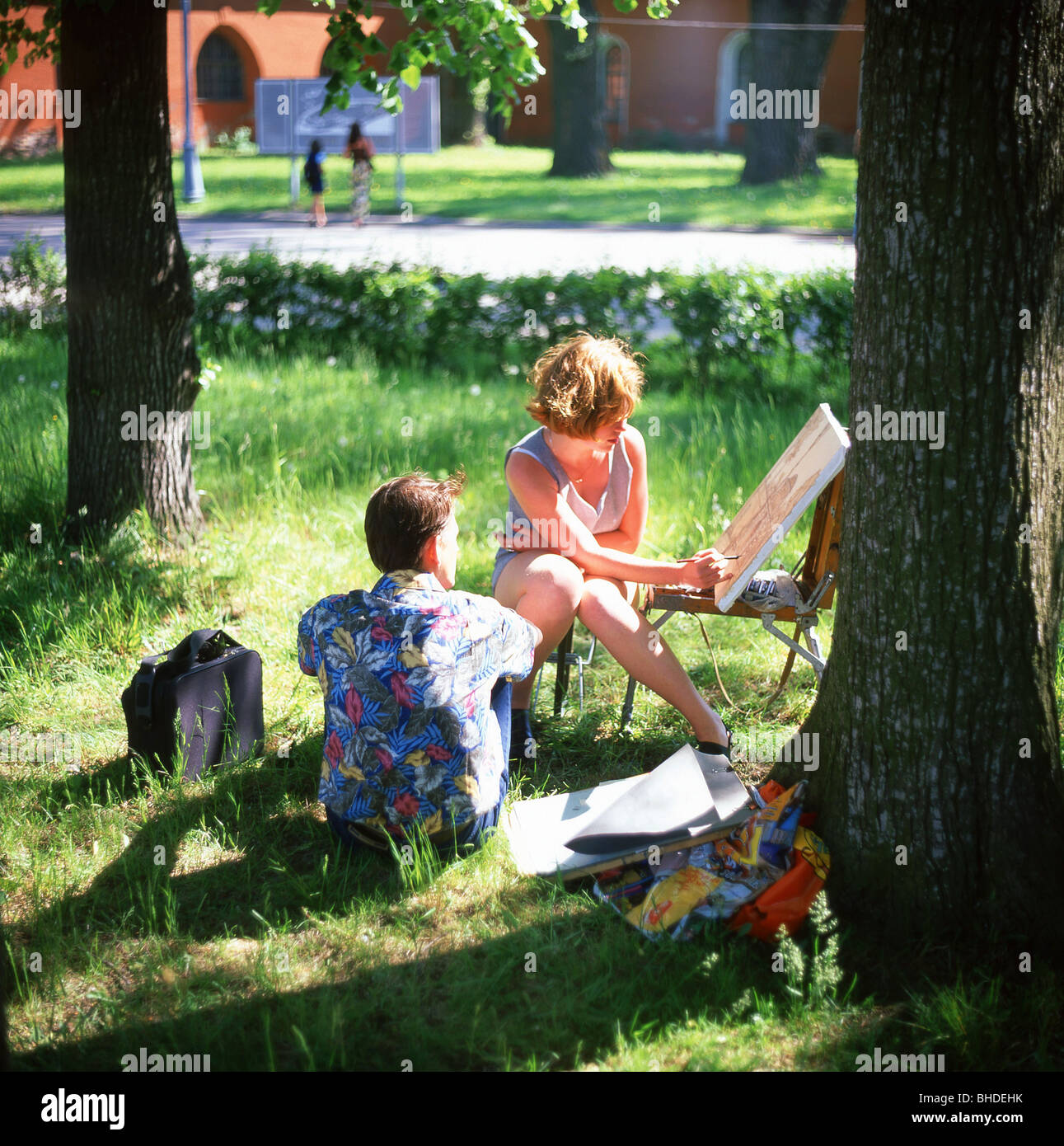 Woman painting in park, Peter and Paul Fortress, Saint Petersburg, Northwestern Region, Russia - Stock Image
