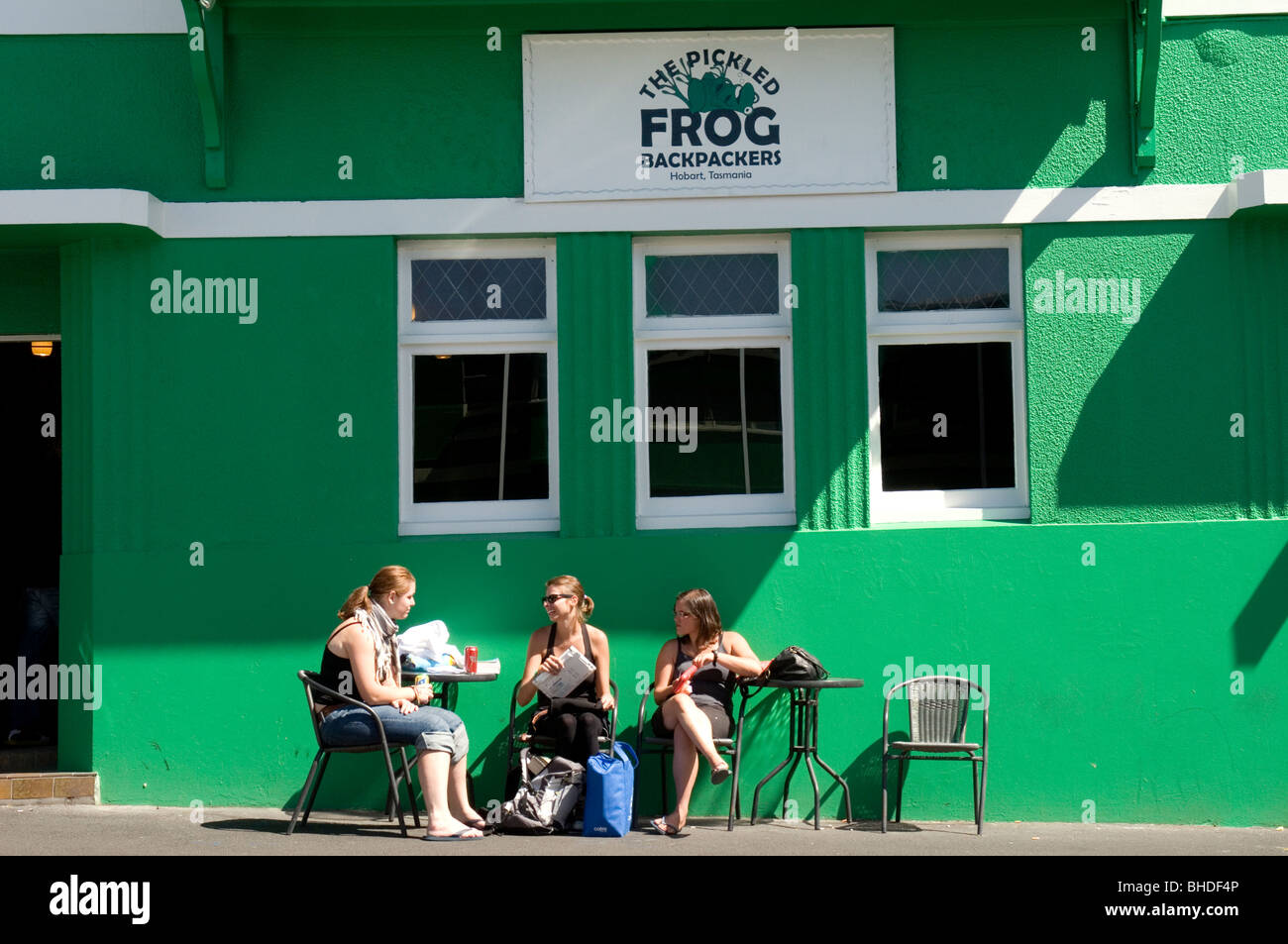 Young travellers relaxing outside a backpacker hostel, Hobart, Tasmania, Australia Stock Photo