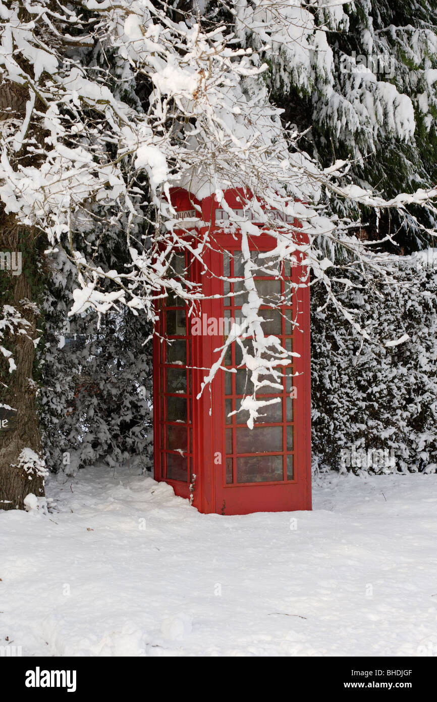 British Red telephone box in the snow - Stock Image