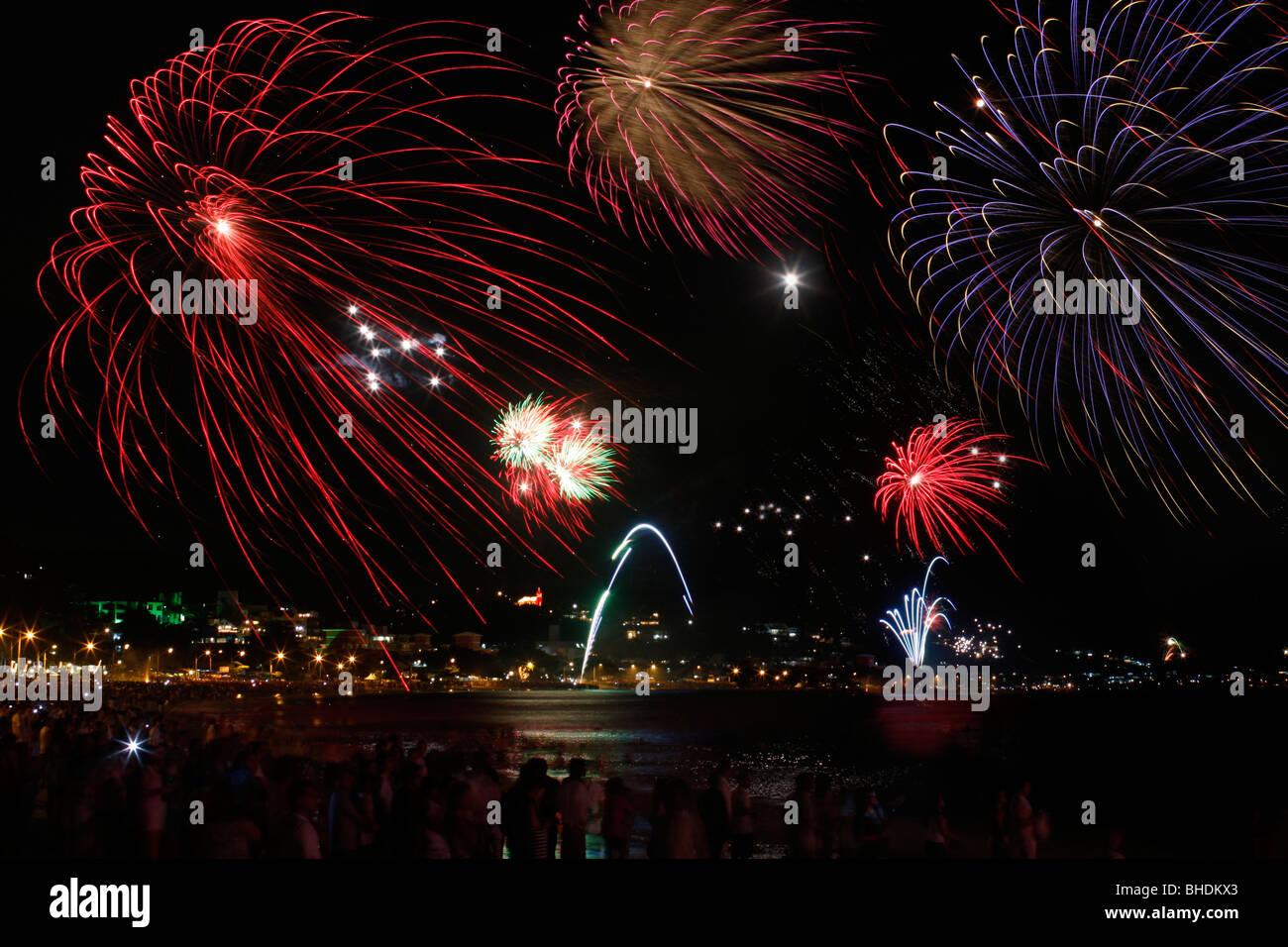 Fireworks celebrating new year on the beach of Bombinhas in Brazil - Stock Image