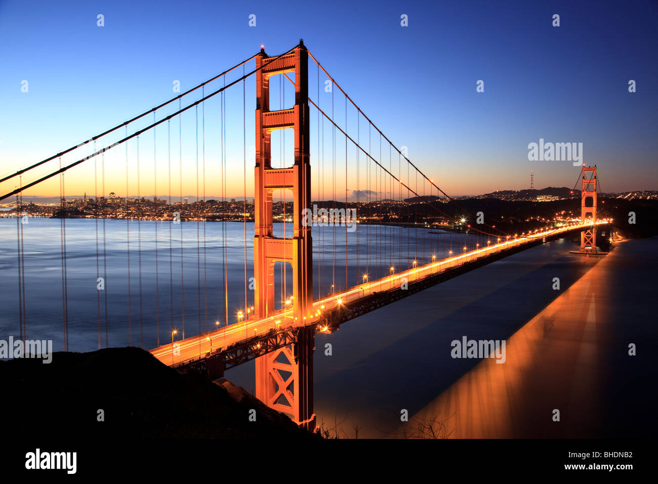 Golden gate Bridge and San Francisco Skyline viewed at dusk - Stock Image