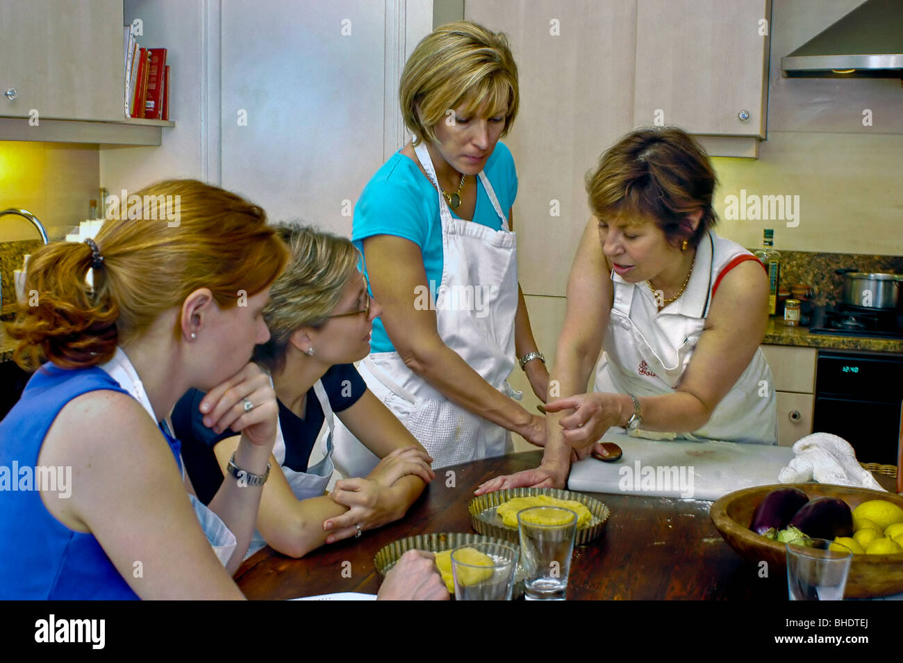 PARIS , France - Mixed Group of American University Students Preparing Meals in Cooking class, 'Promenades Gourmandes', - Stock Image