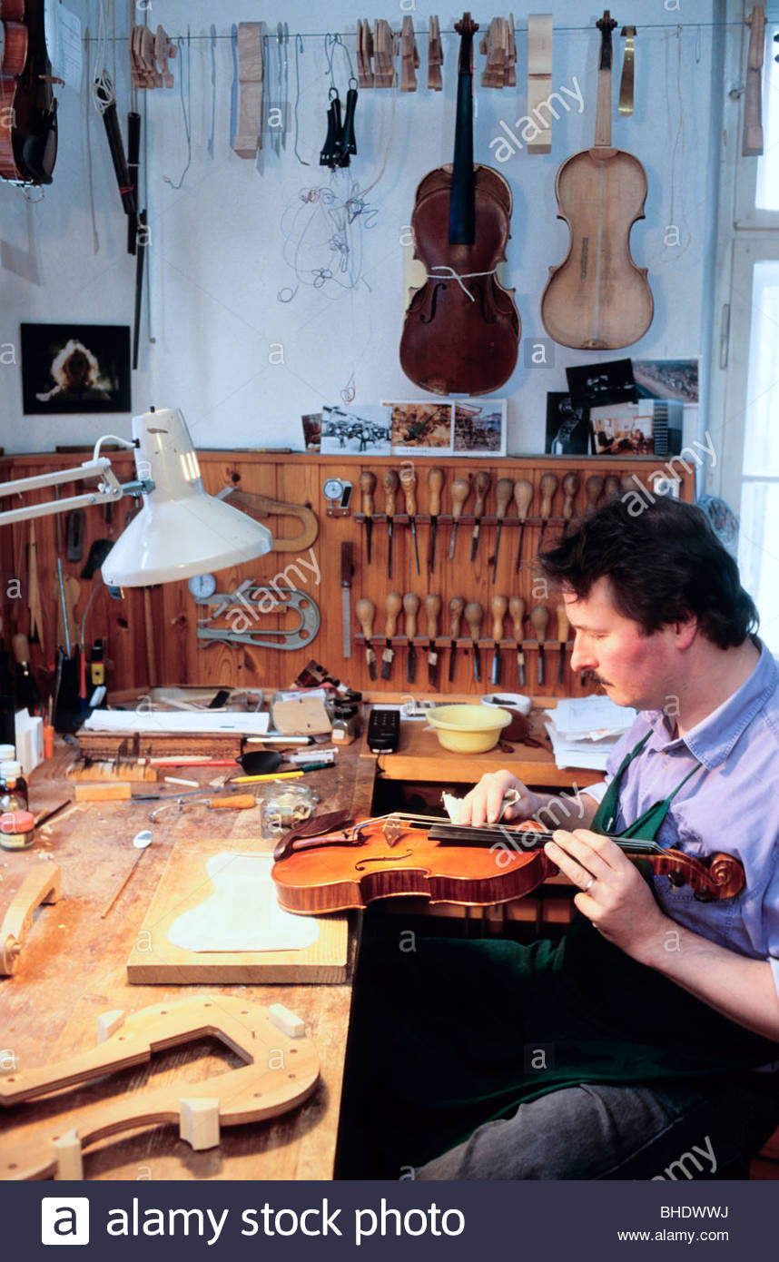 Pierre Chaubert is a stringed-instrument maker in the village of Fussen in the bavarian Alps. Bavaria, germany - Stock Image