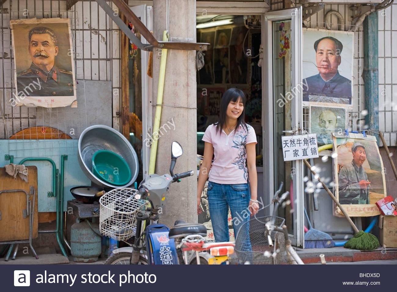 Walking her rabbit in the antique dealer's street. Beijing, china - Stock Image