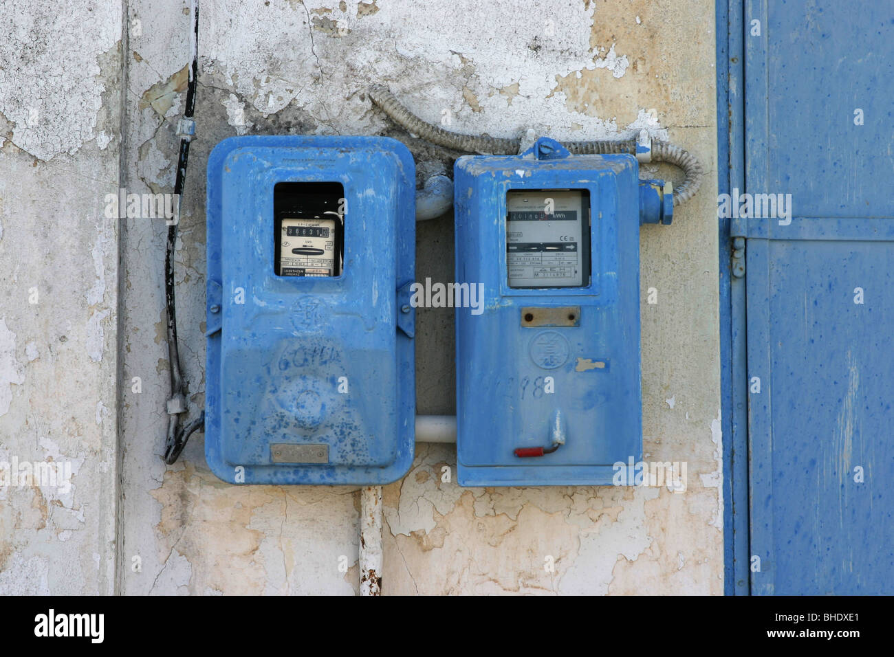 Electricity and gas meter of a Greek house - Stock Image