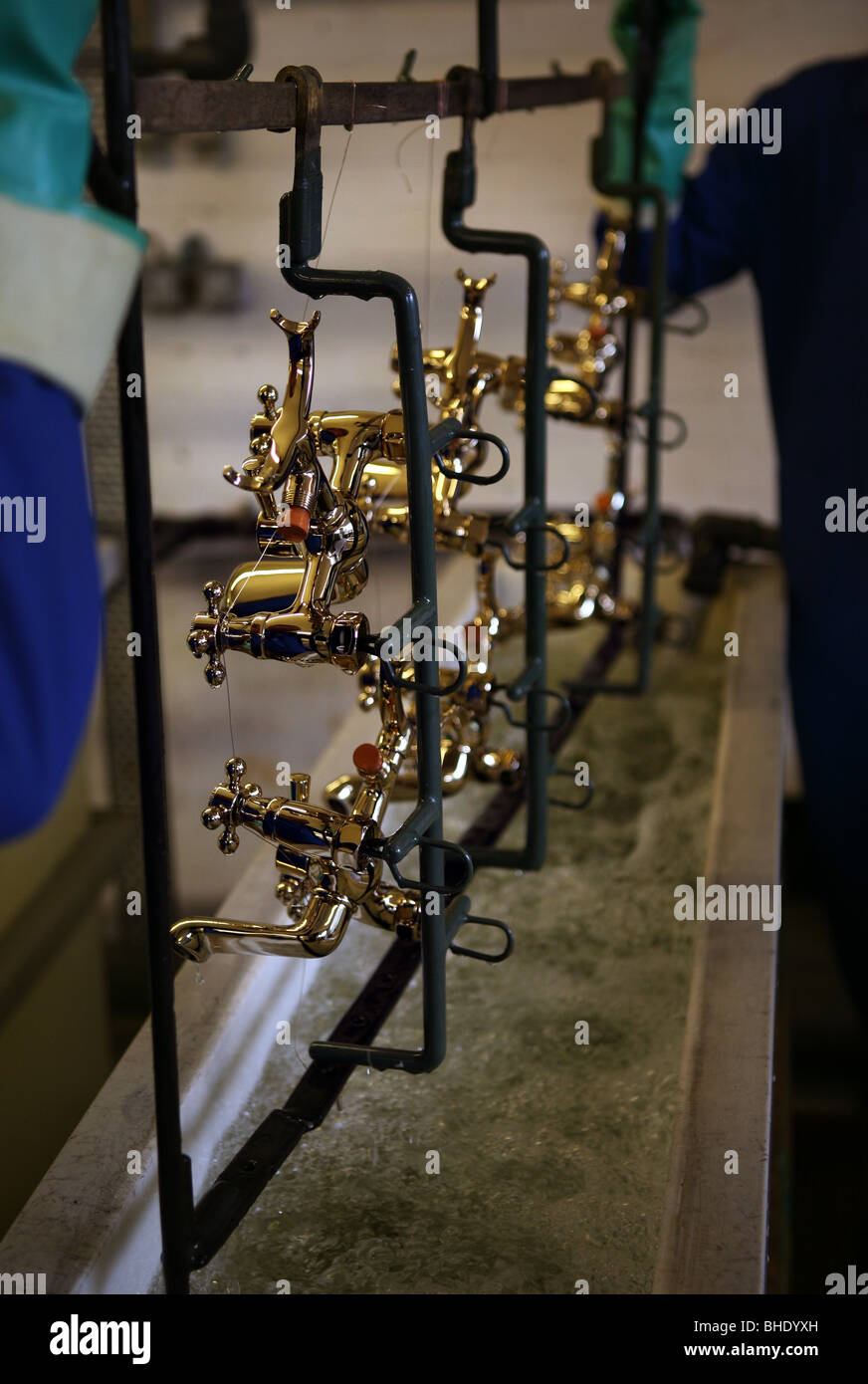 gold plating bathroom taps in the UK - Stock Image
