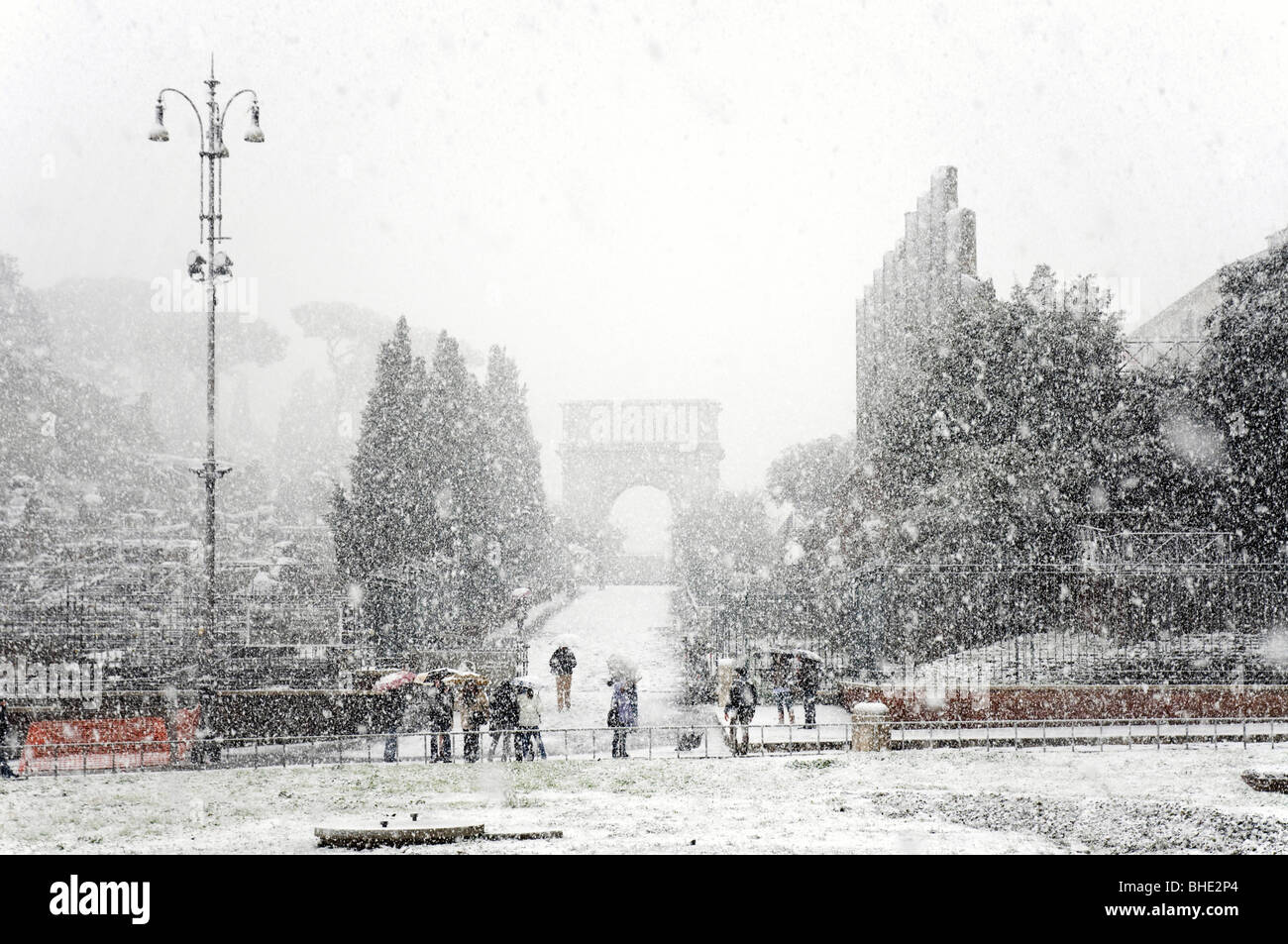 Titus Arch and Via Sacra under heavy snow, Rome Italy - Stock Image