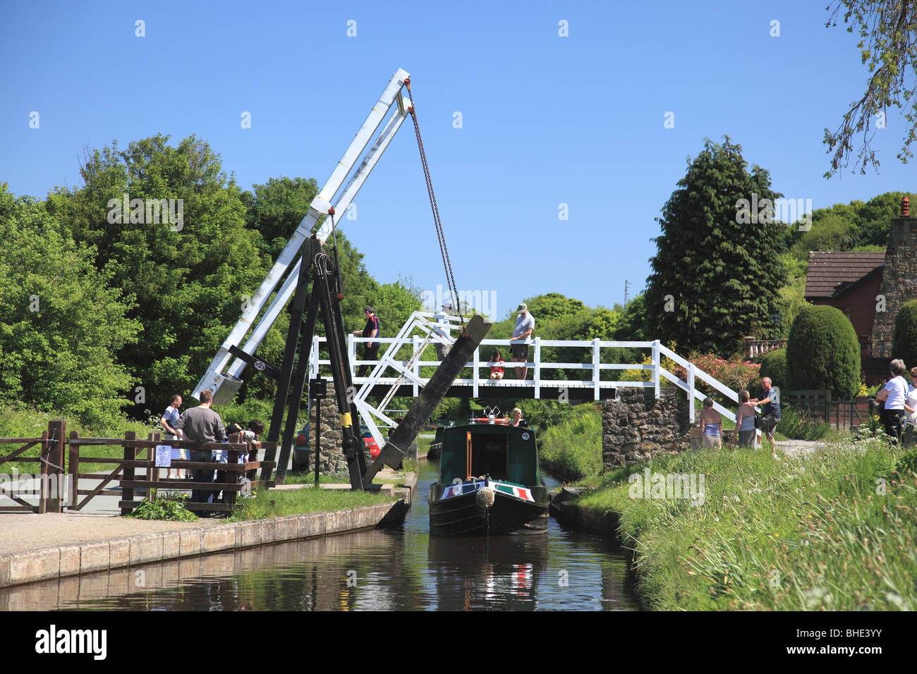 A narrowboat going under Froncysyllte Lift Bridge on the Llangollen Canal - Stock Image