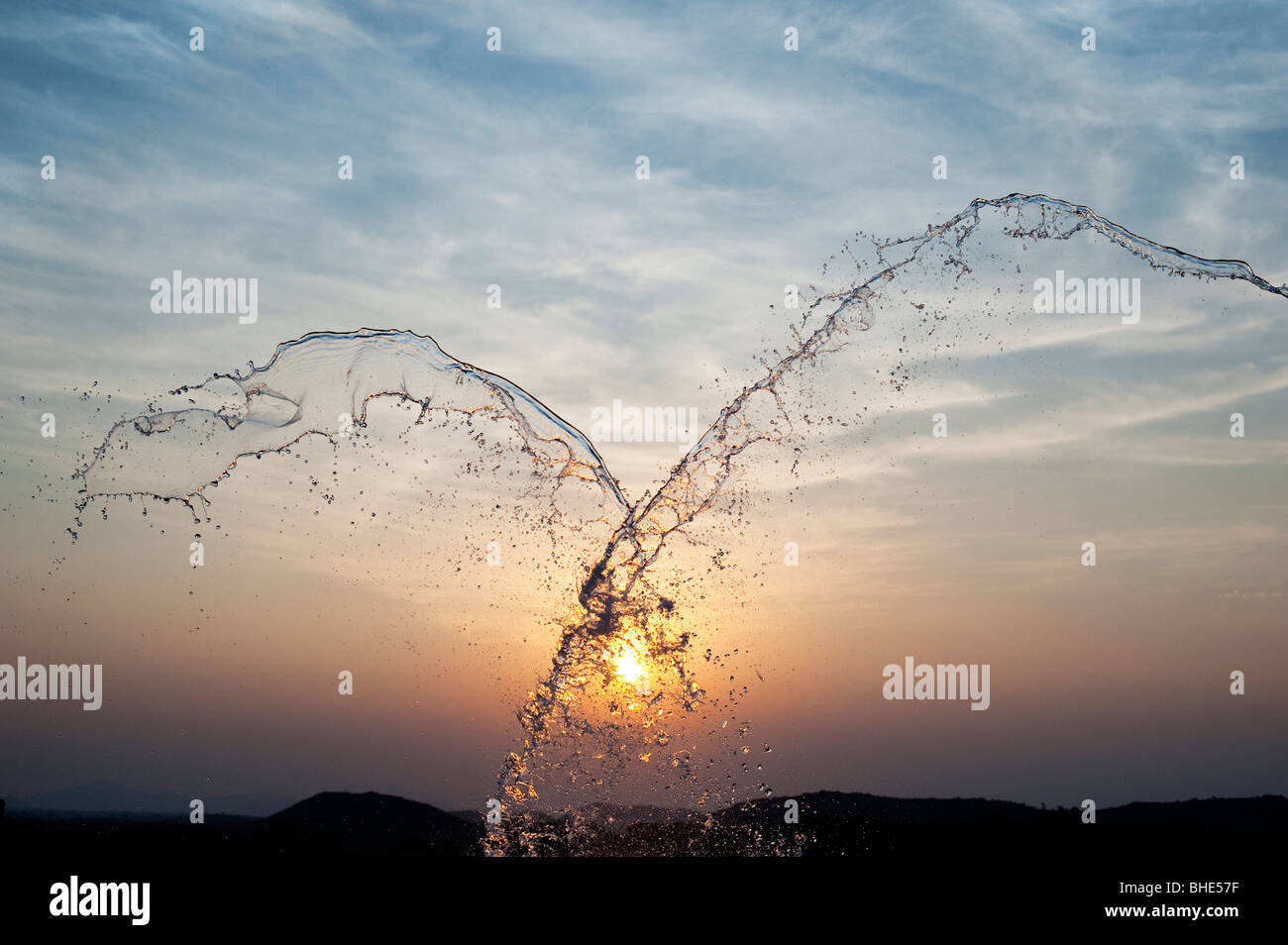 Thrown water against sunset. India - Stock Image