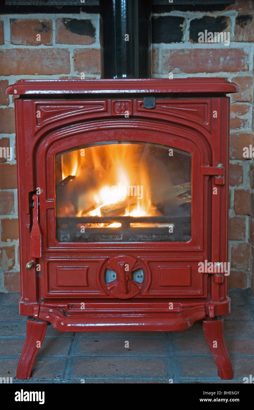 Domestic wood burning fire - Stock Image