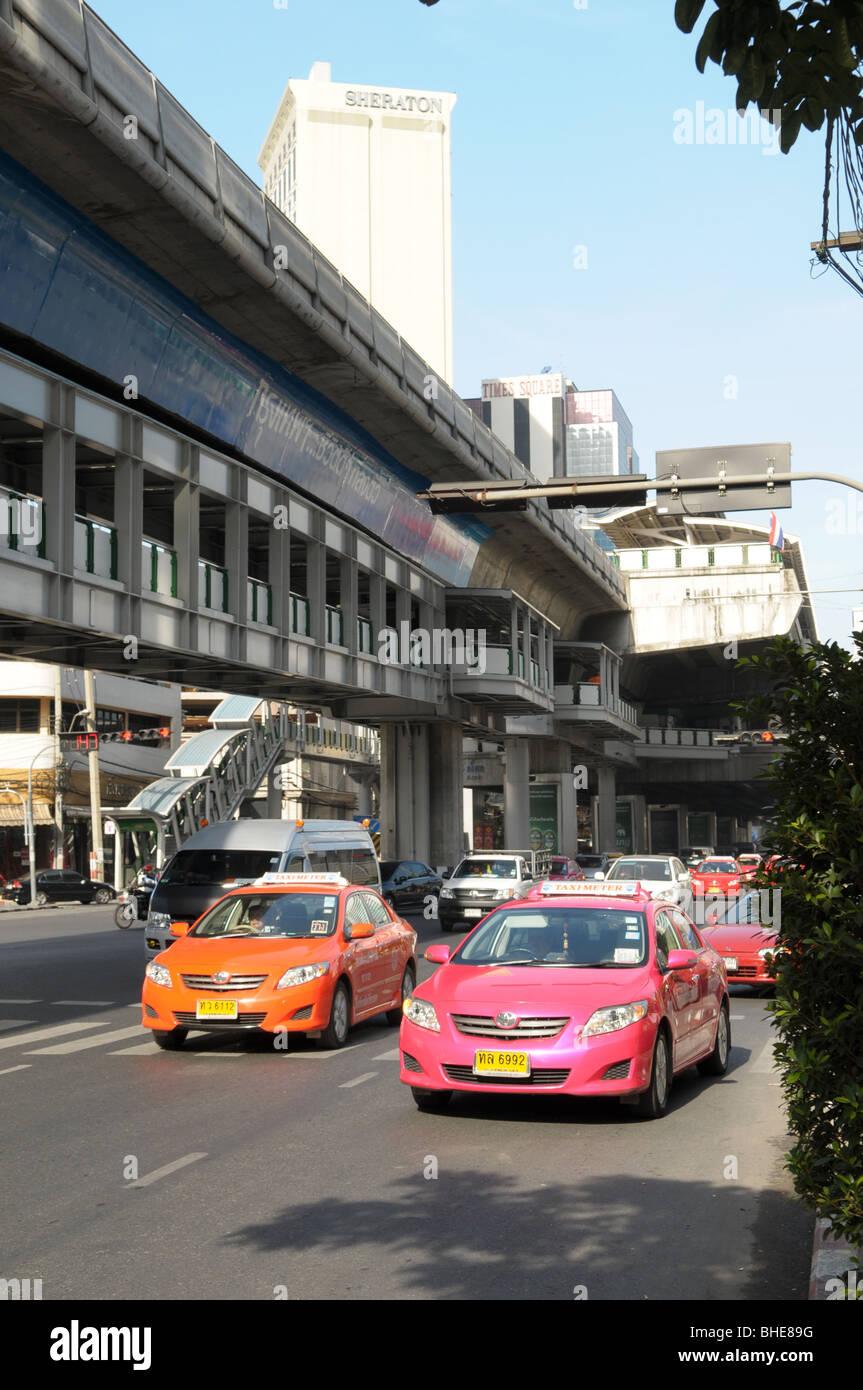 Traffic crawls along Sukhumvit Road near skytrain station Nana Bangkok Thailand. Stock Photo