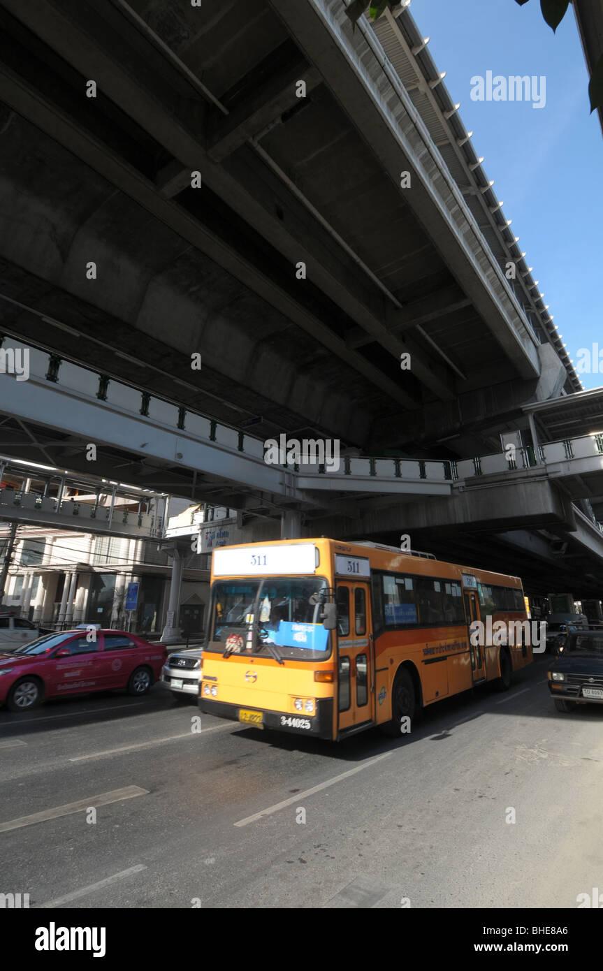 Traffic crawls along Sukhumvit Road below skytrain station Nana Bangkok Thailand. Stock Photo