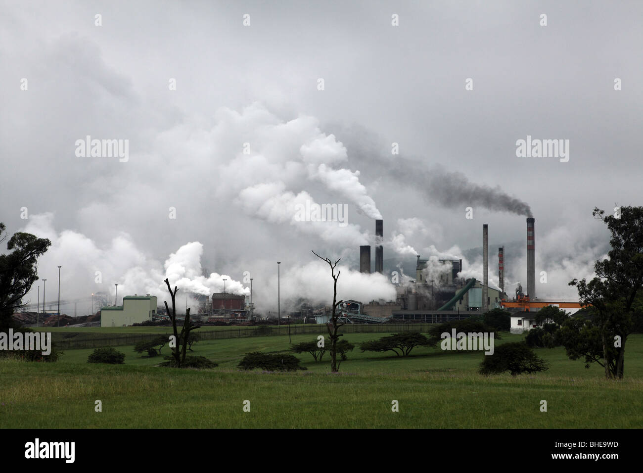 A factory emits smoke from the chimneys at Mandeni South Africa Stock Photo